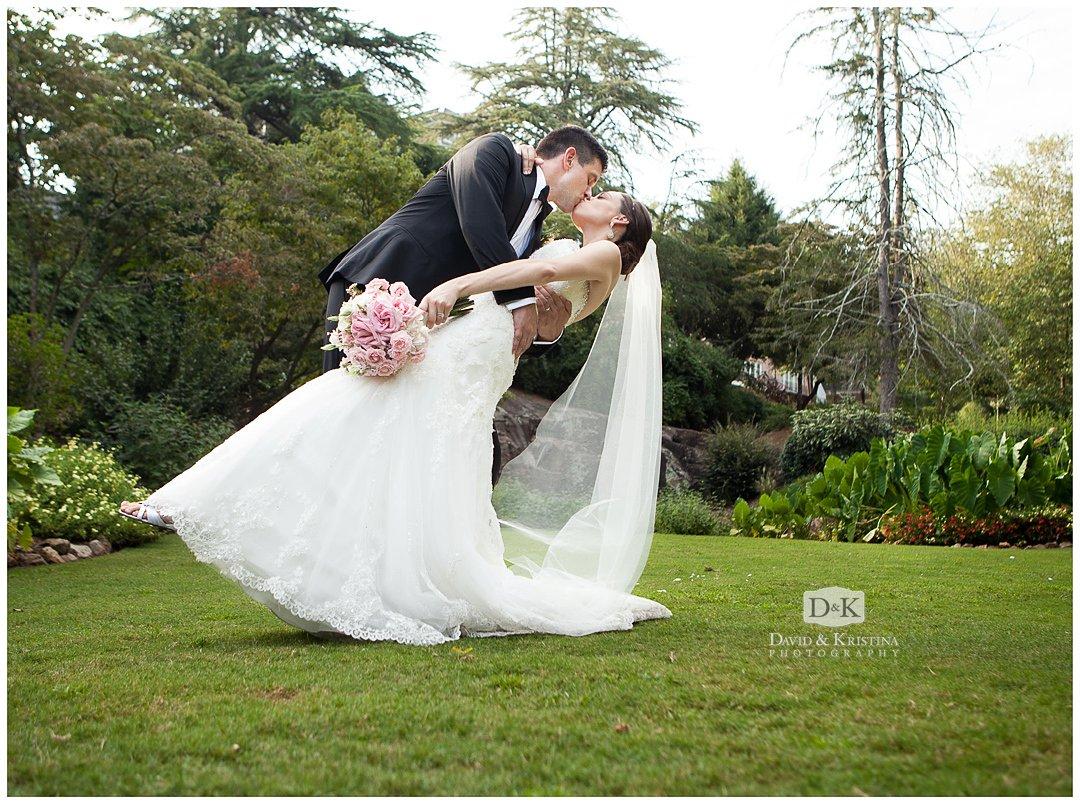 bride and groom dip kiss