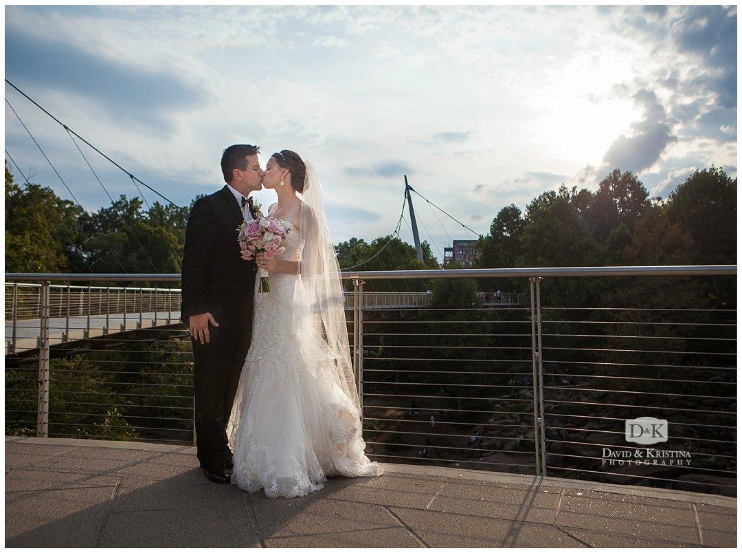 Bride and Groom at Liberty bridge Falls Park