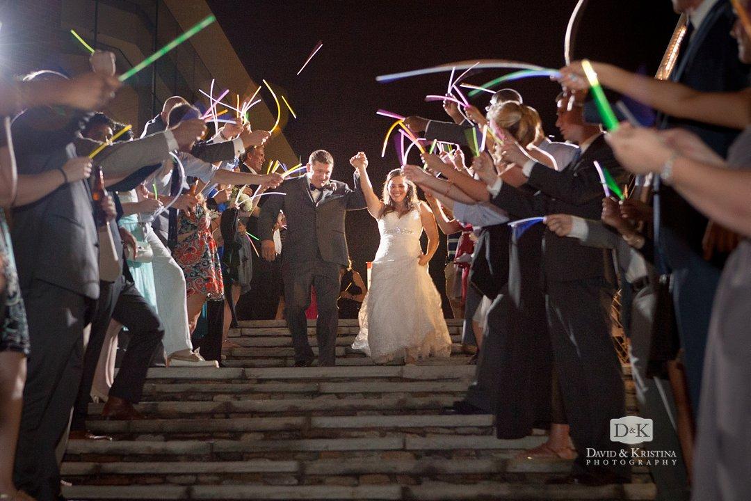 bride and groom exit through glow sticks