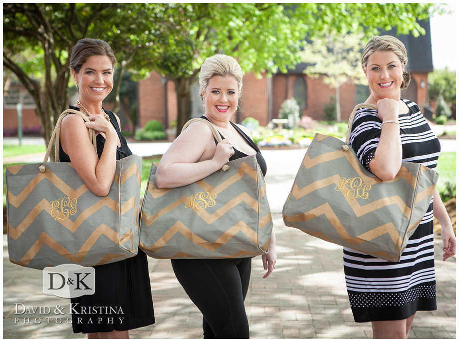 bride and bridesmaids holding monogramed bags