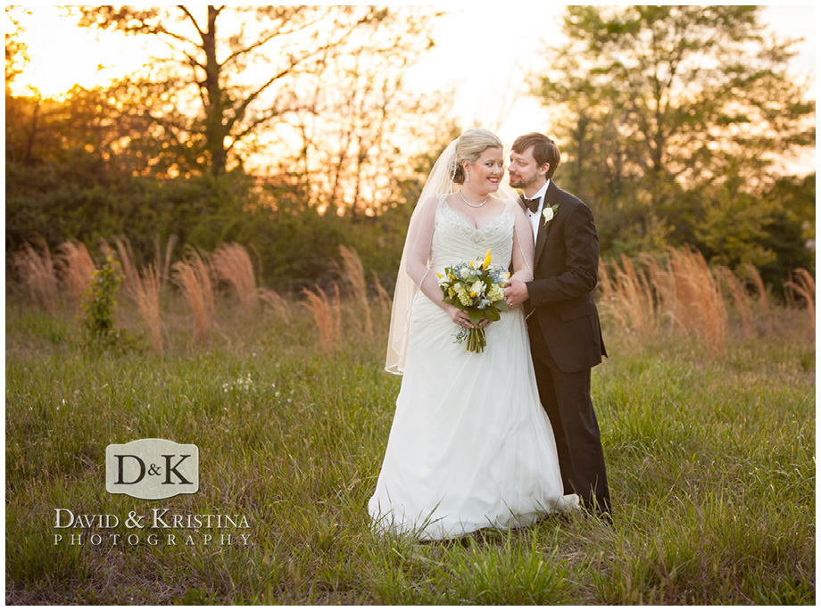 bride and groom pictures in field next to Twigs
