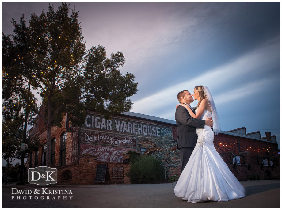 Bride and groom in front of The Old Cigar Warehouse