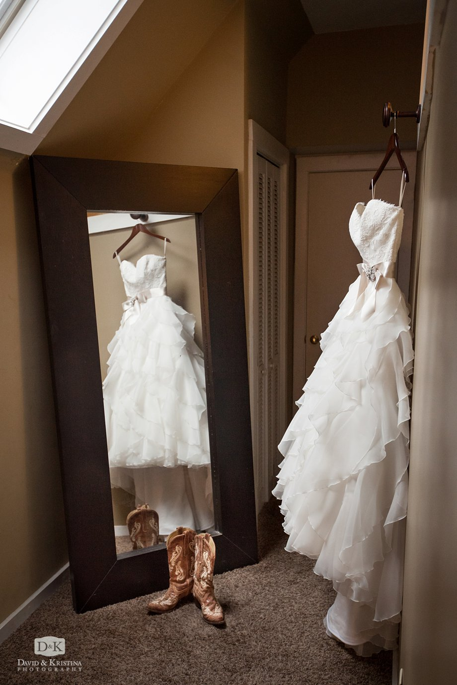 wedding dress and boots in front of mirror