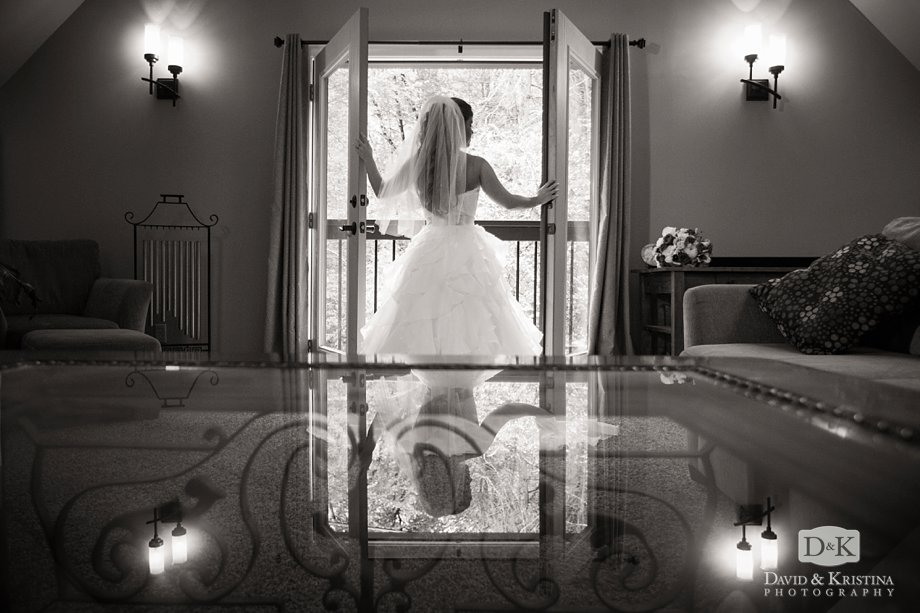 bride's reflection in coffee table