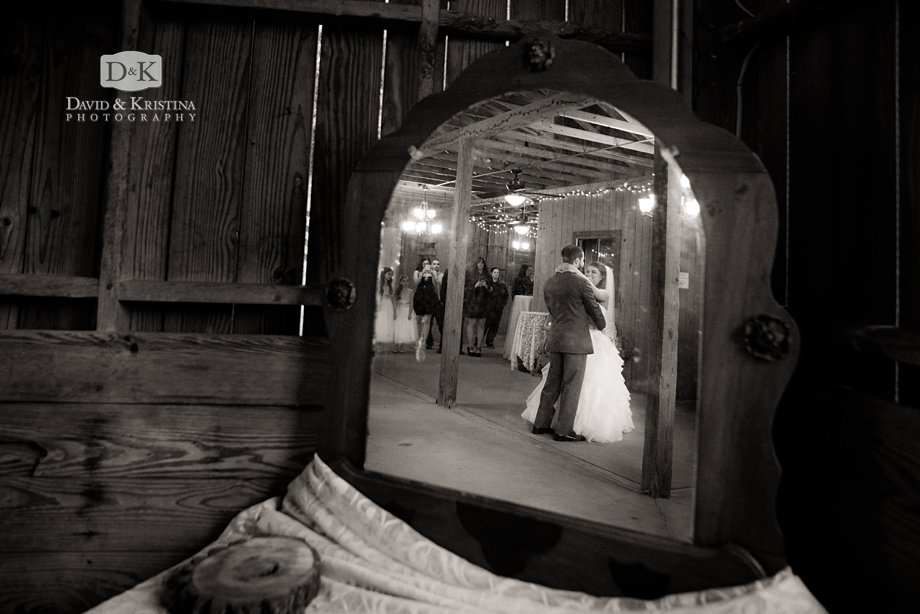 reflection of first dance in antique mirror in wedding at Fields of Blackberry Cove
