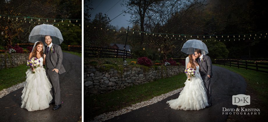 bride and groom in the rain under clear umbrella at The Fields of Blackberry Cove