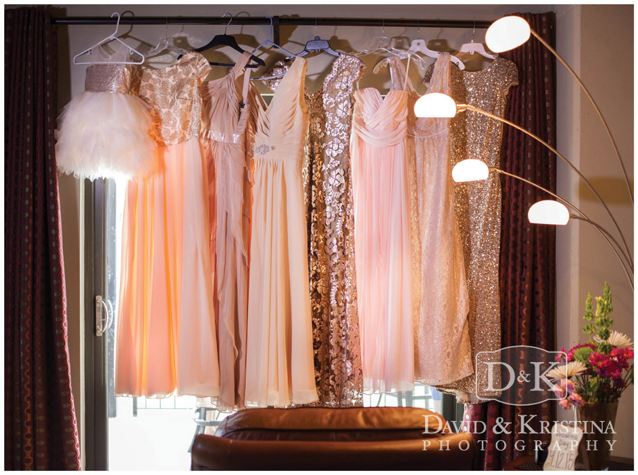 bridesmaid and flower girl dresses hanging in window