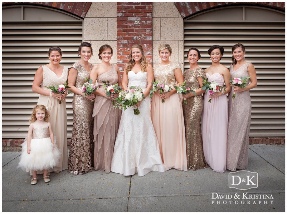 bride with bridesmaids and flower girl in urban street setting