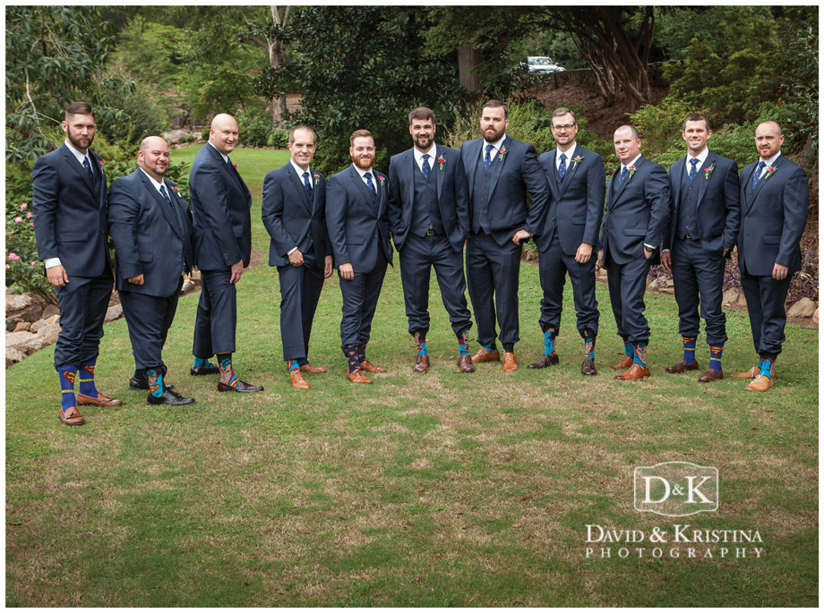 Groomsmen and ushers with superman socks