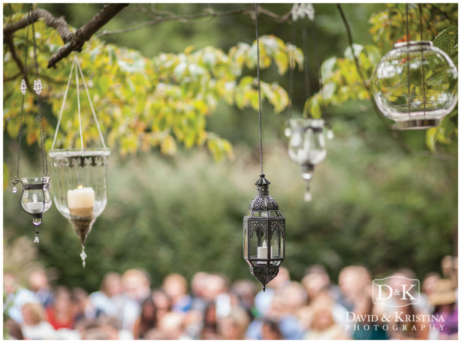 lanterns hanging from tree branches for wedding