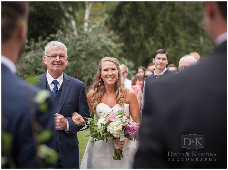 bride walking with her dad toward groom