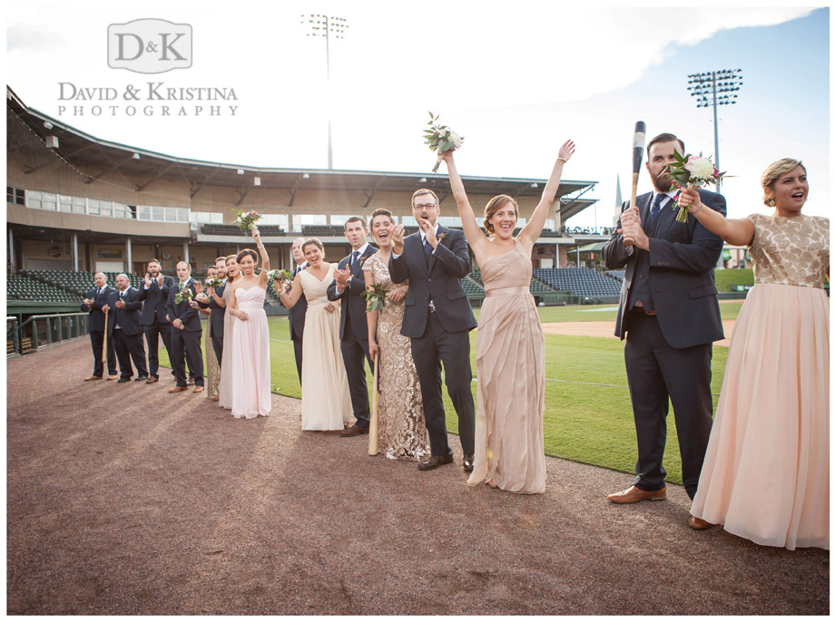 wedding party lined up on baseball field