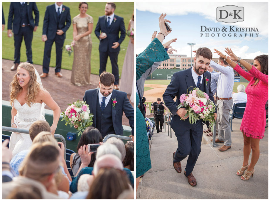 groom holds bouquet as he walks up stadium steps