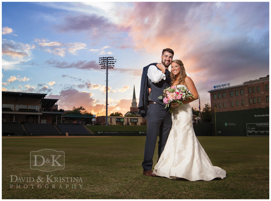 sunset photos of bride and groom on Greenville Drive Baseball Field