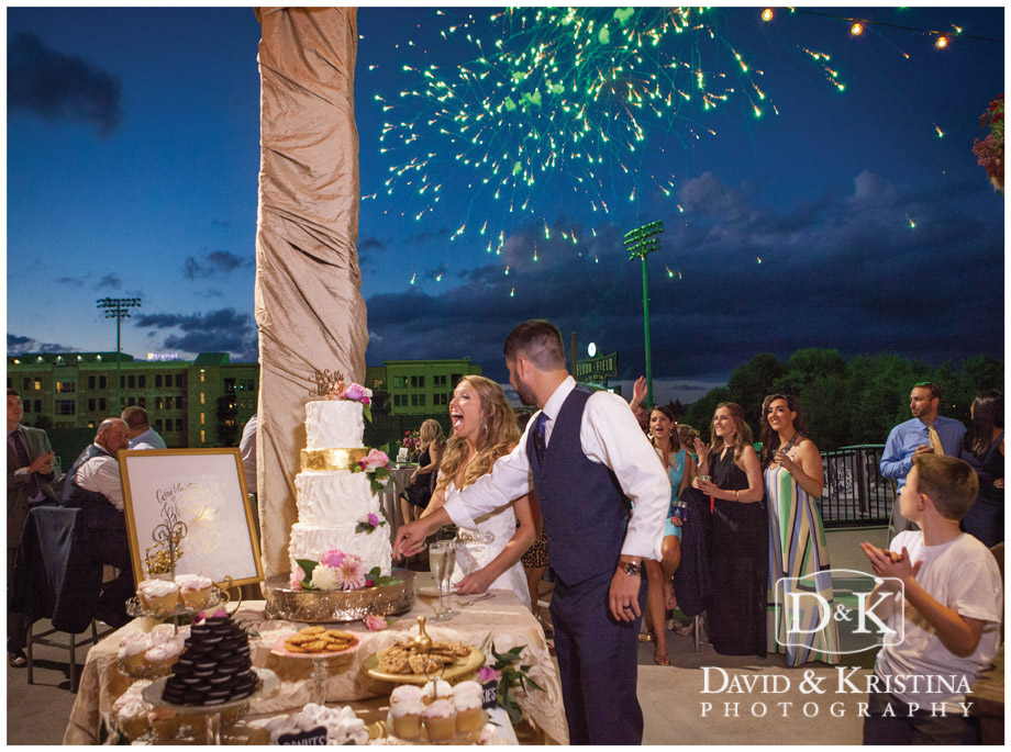 fireworks during cake cutting at Greenville Drive Fluor Field wedding reception