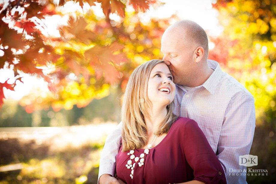 engagement photo with fall leaves