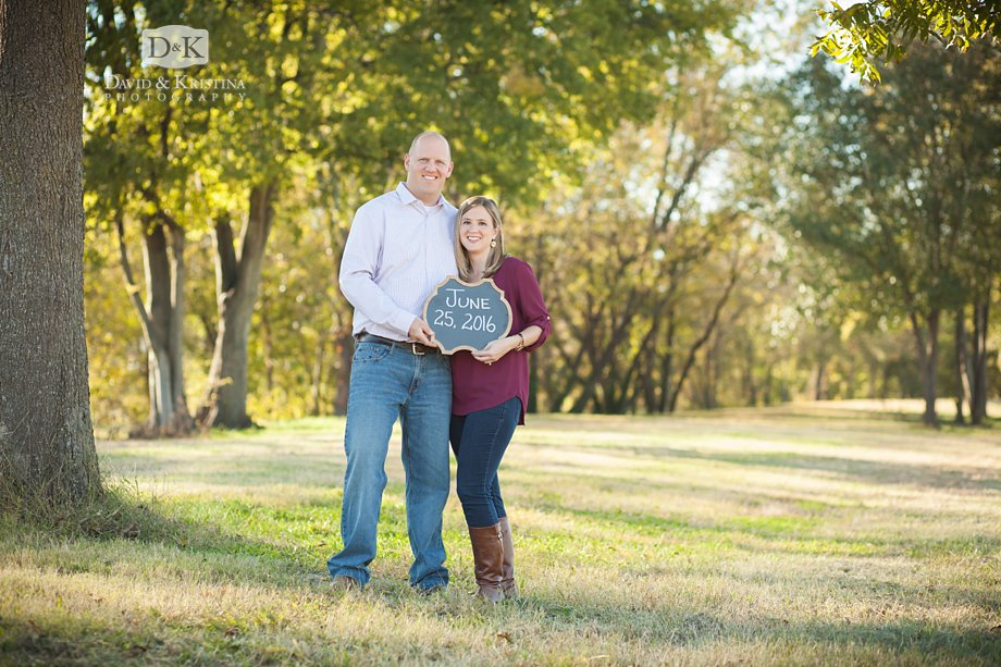 engagement photo with chalkboard sign