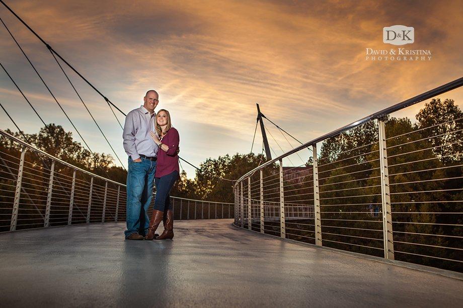 Sunset engagement photo on Liberty Bridge in Falls Park