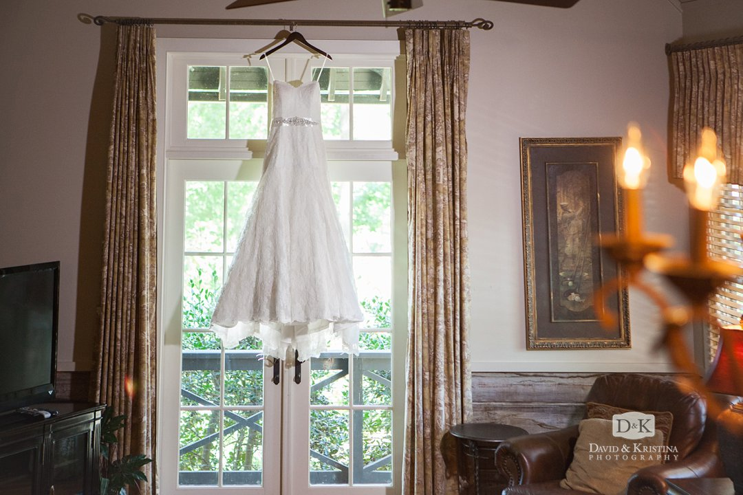 wedding dress hanging in window in cabin at The Reserve at Lake Keowee