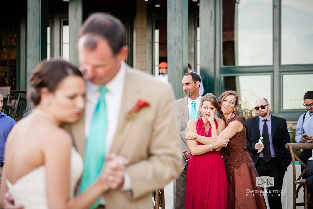 emotional mothers watch father daughter dance