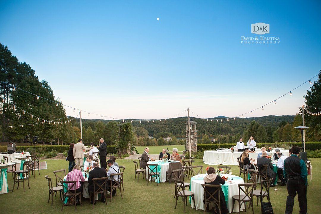 early October moon over lake Keowee at the Orchard Clubhouse wedding reception