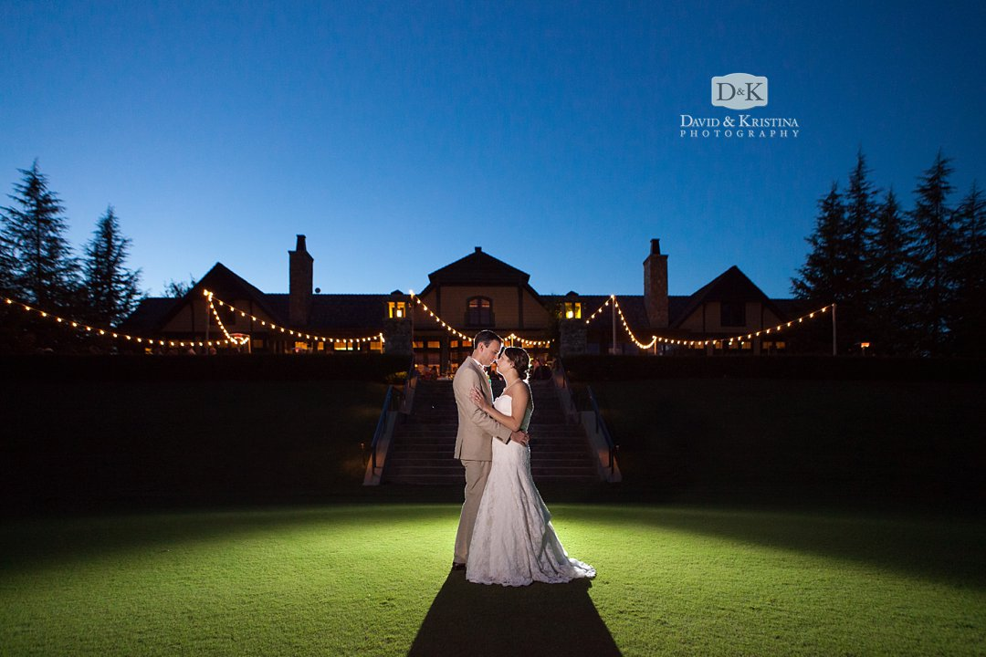 dramatic shot of bride and groom in front of their reception at The Reserve at Lake Keowee Orchard Clubhouse