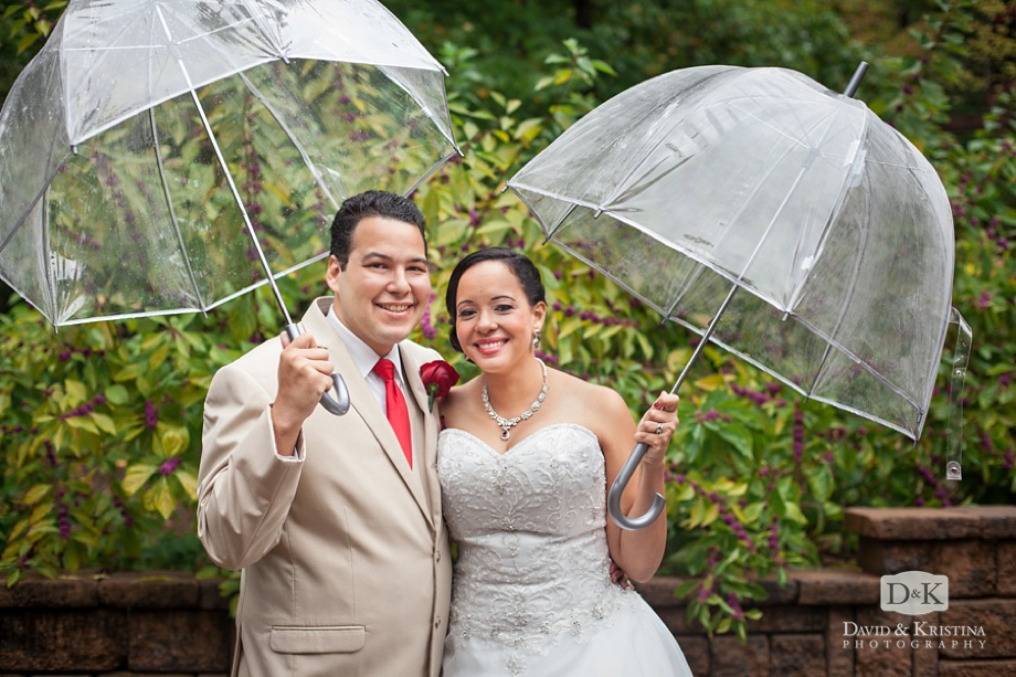 bride and groom with clear umbrellas