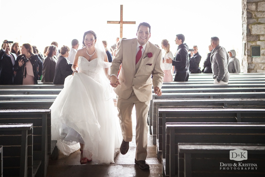 bride and groom recess up the aisle at Symmes Chapel