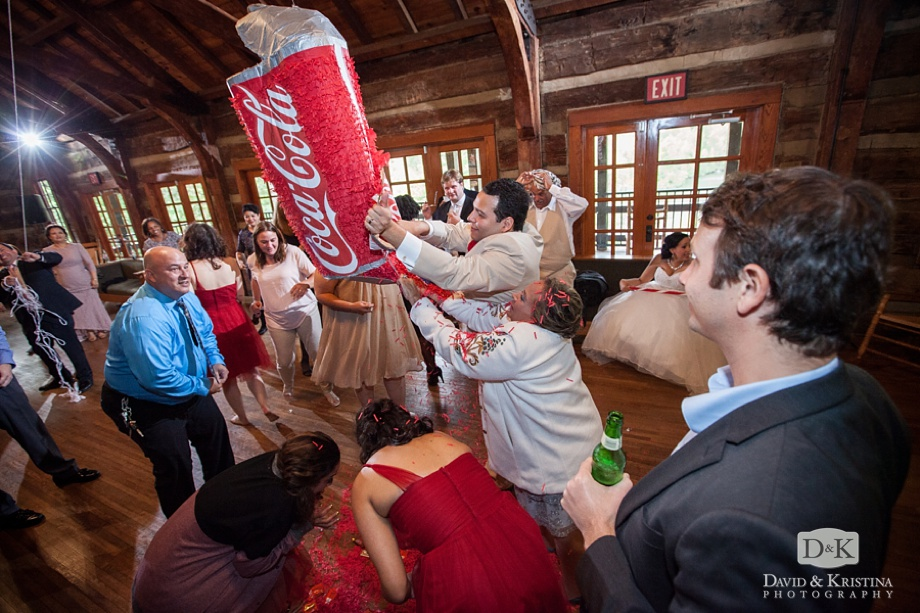 The Coke piñata is torn open and everyone dives for the goodies
