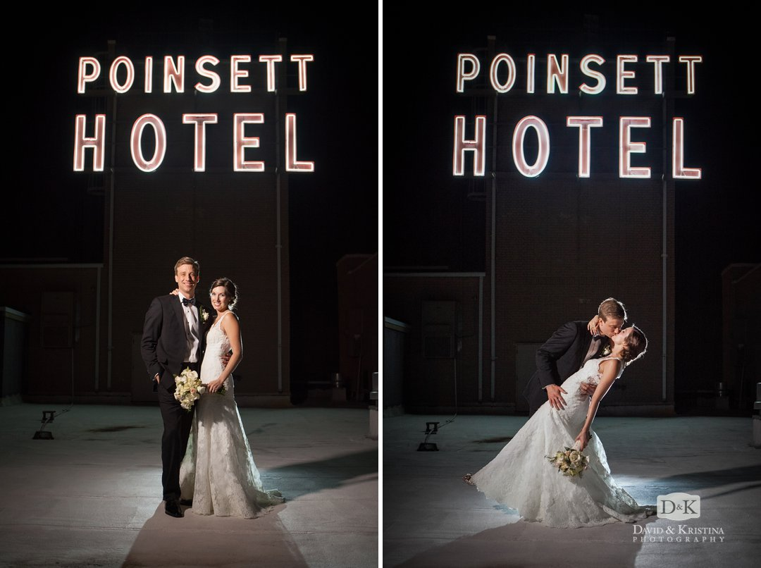 Bride and groom on Poinsett Hotel rooftop in front of sign