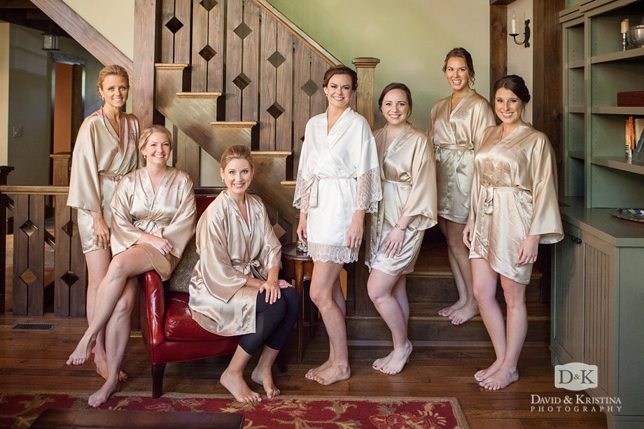 bridesmaids in robes before putting on dresses