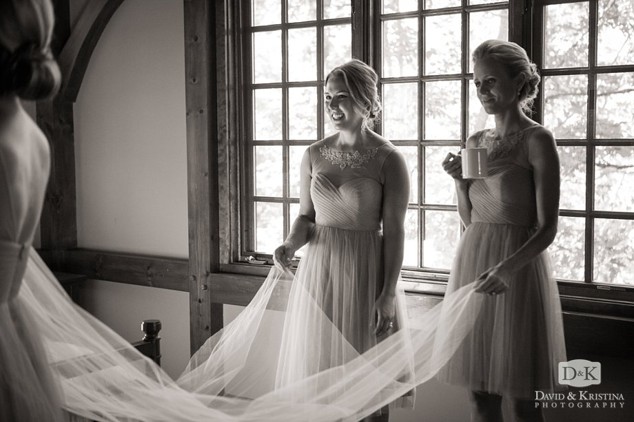 bridesmaids holding veil
