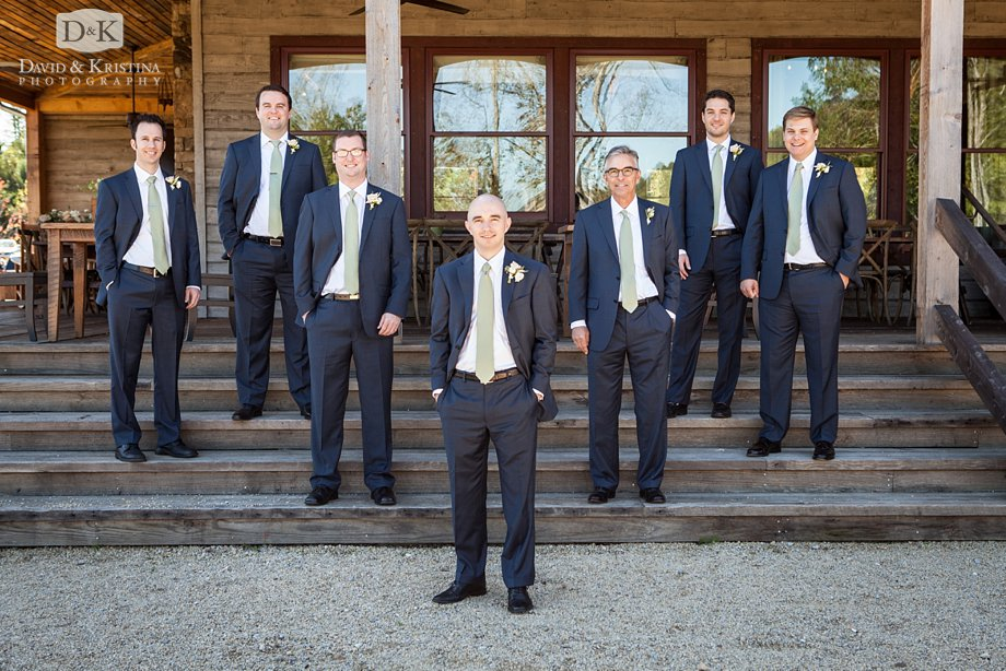 groomsmen on the back steps of the cabin at The Cliffs at Mountain Park