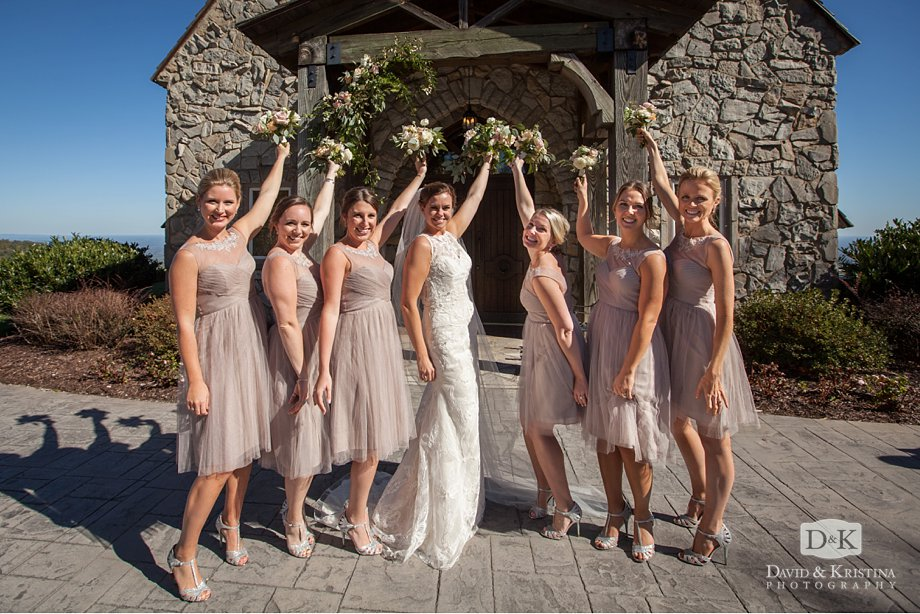 Bride and bridesmaids hold their bouquets in front of the Cliffs Chapel
