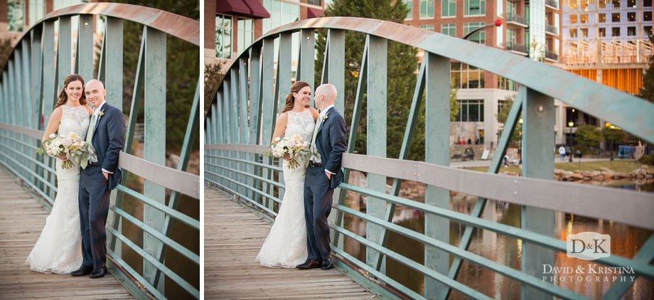 bride and groom on green metal walking bridge by the Wyche Pavilion