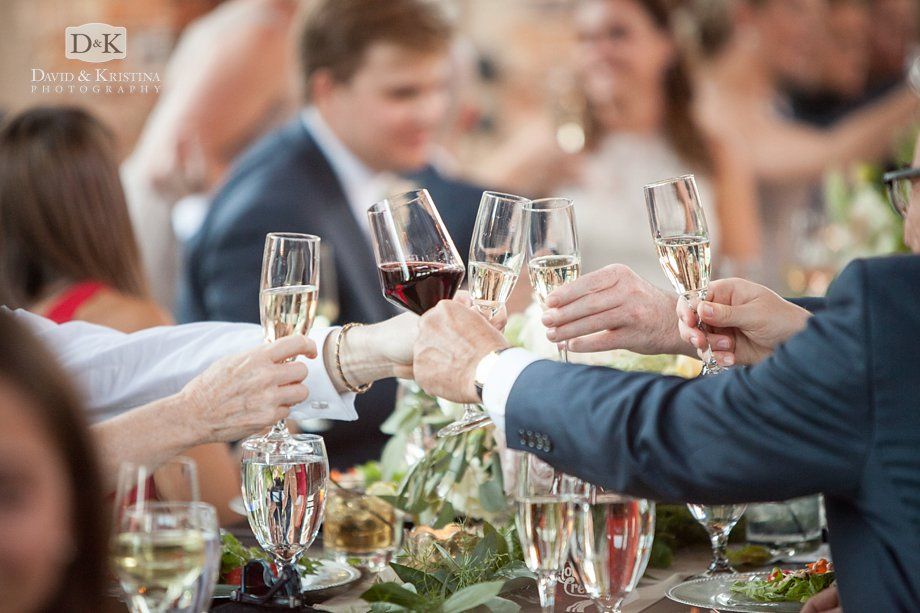 glasses clinking during wedding toasts