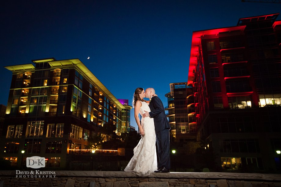bride and groom at twilight in Downtown Greenville on the Reedy River.