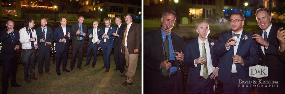 gentlemen smoke cigars during outdoor wedding reception