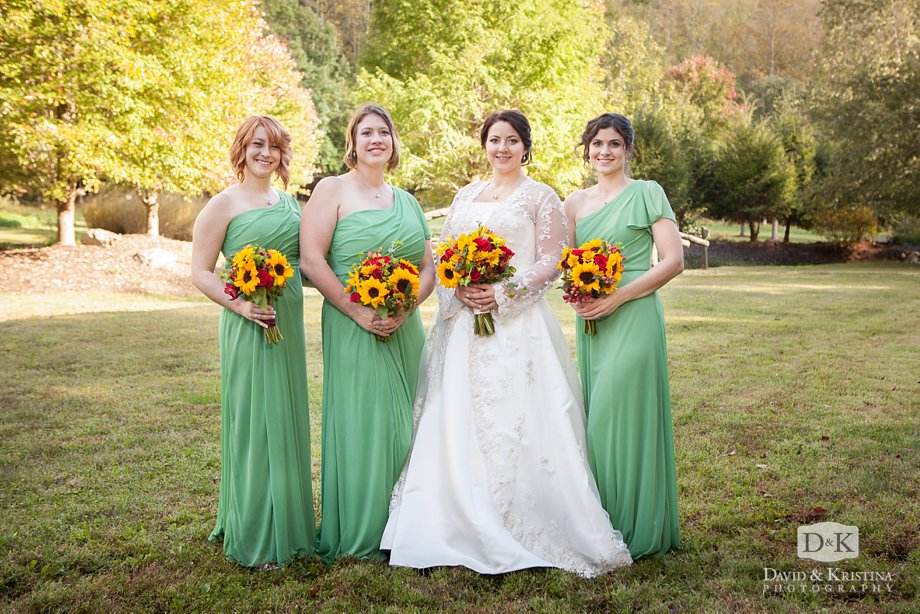 bride with bridesmaids wearing mint green dresses