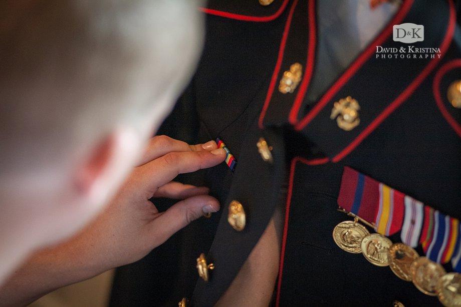 Zak pinning ribbons on jacket