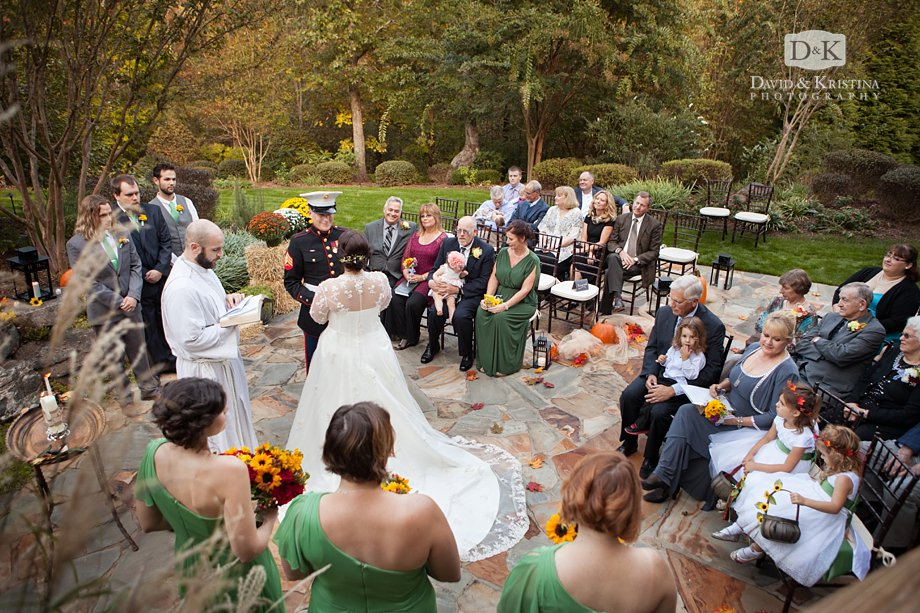 intimate wedding on a stone patio in the backyard