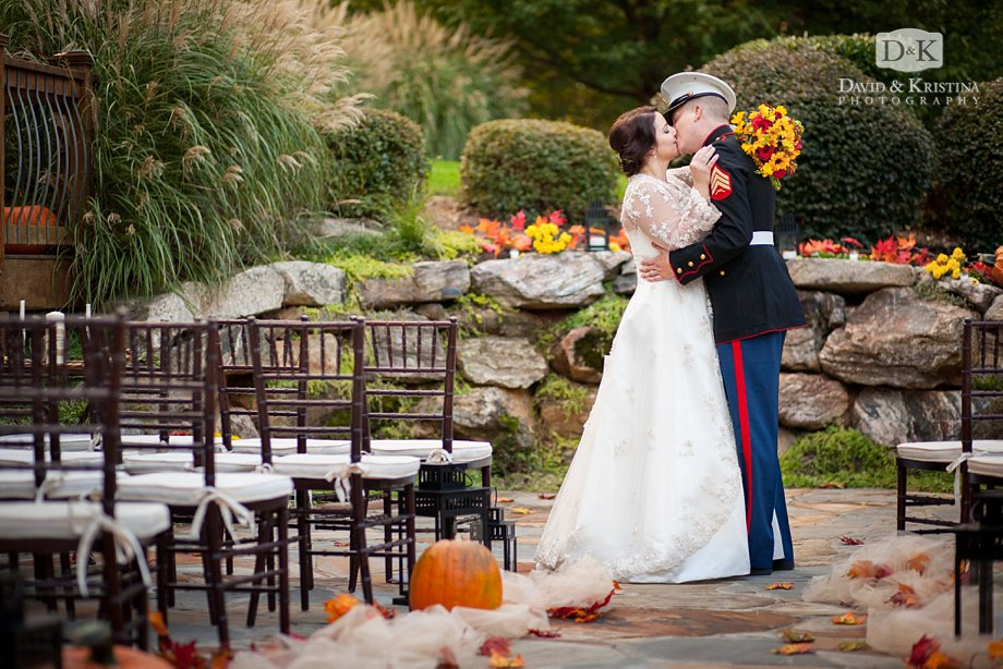Zak and Meredith kissing on the patio after their wedding