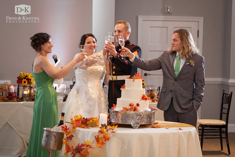 bride and groom toast with best man and maid of honor