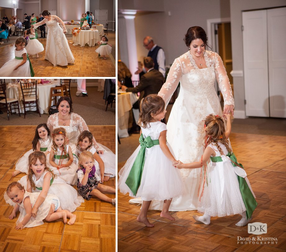 bride with flower girls on the dance floor