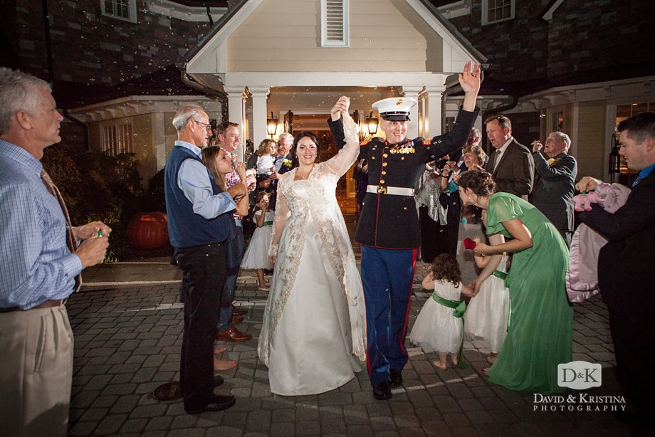 bride and groom walk out through bubbles from the Cliffs Valley Clubhouse