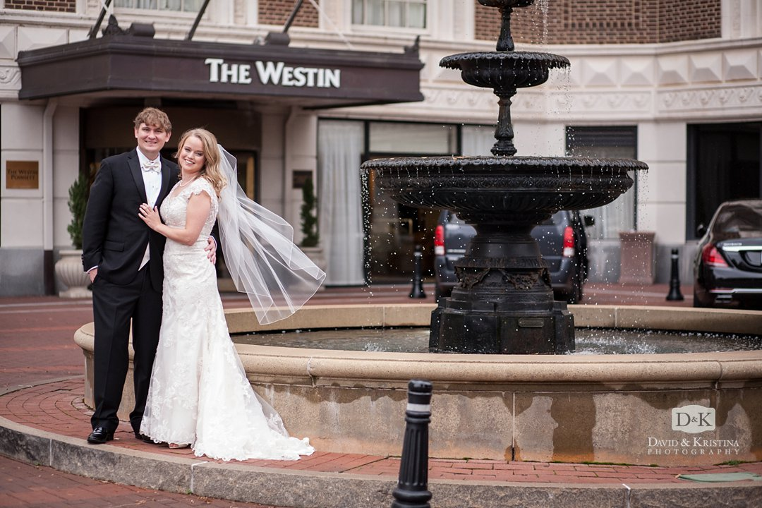 bride and groom at fountain at The Westin Poinsett