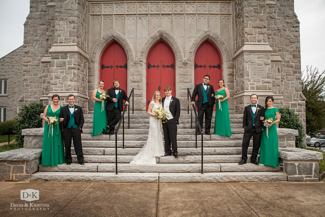 wedding party photos on steps of Trinity Lutheran Church