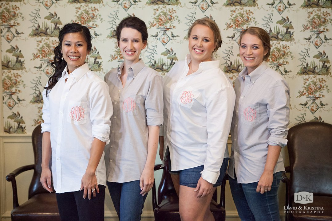 bride and bridesmaids with monogramed shirts