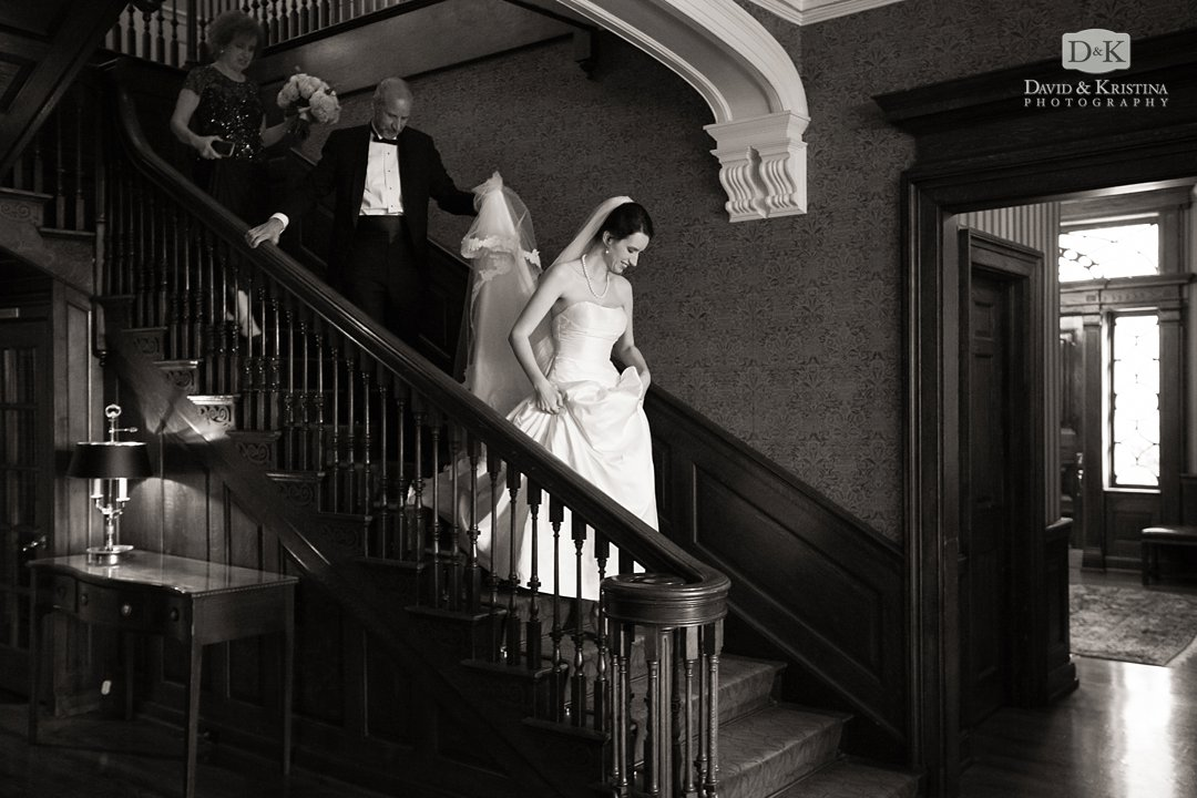 Catie walking down the stairs at The Poinsett Club