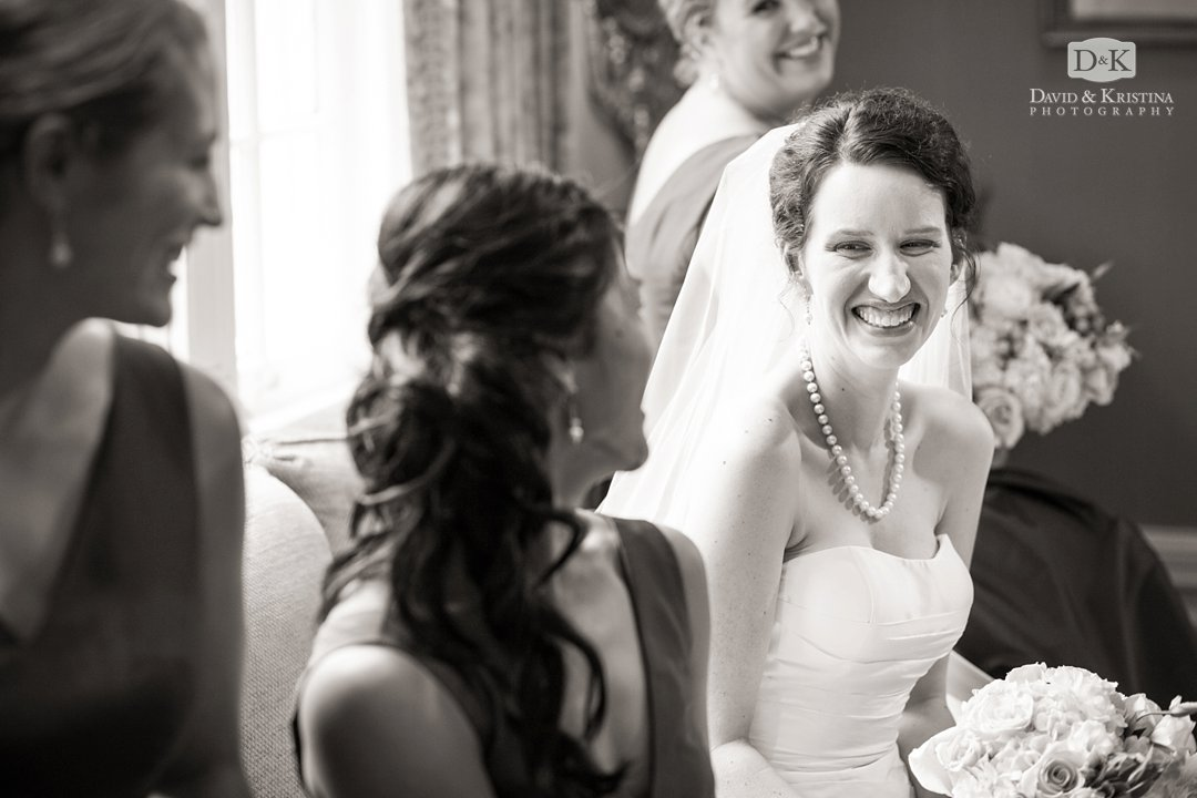 Catie laughing with bridesmaids before wedding